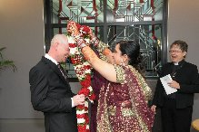 Monica and Beau exchanging garlands at their ceremony at Mississauga City Hall