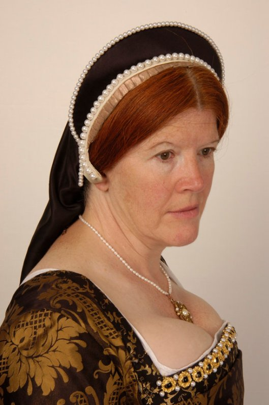 French Hood from The Tudor Tailor on Etsy. They sell patterns for just about everything tudor.
