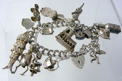 A chunky silver charm bracelet from the 1960's.