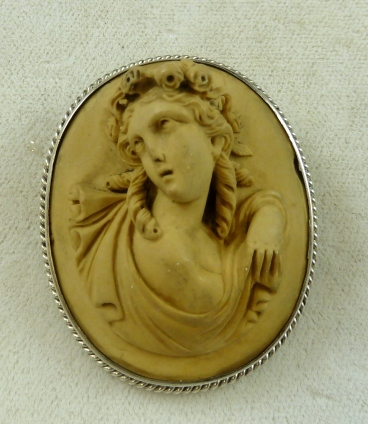 http://www.ebay.co.uk/itm/LOVELY-VICTORIAN-STERLING-SILVER-VOLCANIC-LAVA-PORTRAIT-CAMEO-BROOCH-CIRCA-1860-/190706549663