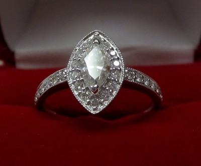 A sterling silver ring with diamonds would be difficult to resize because the heating process could cause the diamonds to pop out. Photo Source ~ ebay.com